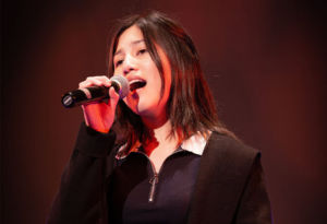 Student Crystal singing at a HSC showcase